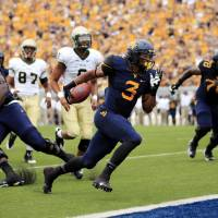 Photo - West Virginia running back Charles Sims (3) crosses scores a touchdown during the first quarter of aneir NCAA college football game against William and Mary in Morgantown, W.Va., on Saturday, Aug. 31, 2013. (AP Photo/Christopher Jackson ORG XMIT: WVCJ103