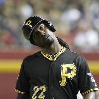 Photo - Pittsburgh Pirates' Andrew McCutchen reacts after grounding out against the Arizona Diamondbacks during the fourth inning of a baseball game, Friday, Aug. 1, 2014, in Phoenix. (AP Photo/Ralph Freso)