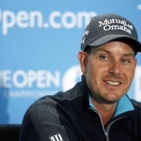 Photo - Henrik Stenson of Sweden smiles during a press conference ahead of the British Open Golf championship at the Royal Liverpool golf club, Hoylake, England, Wednesday July 16, 2014. The British Open Golf championship starts Thursday July 17. (AP Photo/Alastair Grant)
