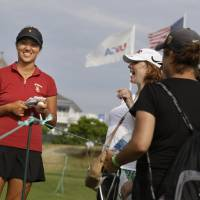 Photo - Annie Park talks to fans during a practice round for the U.S. Women's Open golf tournament at Sebonack Golf Club in Southampton, N.Y., Wednesday, June 26, 2013.   (AP Photo/Seth Wenig)