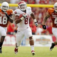 Photo - OU's Dominique Whaley (8) breaks away from UT's Emmanuel Acho (18) and Kenny Vaccaro (4) on a touchdown run in the second half during the Red River Rivalry college football game between the University of Oklahoma Sooners (OU) and the University of Texas Longhorns (UT) at the Cotton Bowl in Dallas, Friday, Oct. 7, 2011. OU won, 55-17. Photo by Nate Billings, The Oklahoman