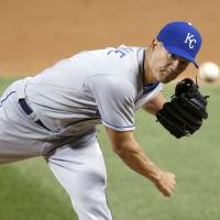 Photo - Kansas City Royals starting pitcher Jeremy Guthrie delivers during the first inning of a baseball game against the Chicago White Sox on Thursday, Sept. 26, 2013, in Chicago. (AP Photo/Charles Rex Arbogast)