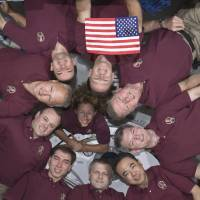 Photo -   In an occurrence which became somewhat of a tradition for shuttle crews and those of the International Space Station expeditions, the Expedition 28 crew and the STS-135 Atlantis astronauts formed a microgravity circle for a portrait Friday July 15, 2011 aboard the orbiting complex's Kibo laboratory of the Japan Aerospace Exploration Agency in this image provided by NASA. The STS-135 crew consists of NASA astronauts Chris Ferguson, Doug Hurley, Sandy Magnus and Rex Walheim; the Expedition 28 crewmembers are JAXA astronaut Satoshi Furukawa, NASA astronauts Ron Garan and Mike Fossum, and Russian cosmonauts Andrey Borisenko, Alexander Samokutyaev and Sergei Volkov. Shuttle and station commanders Ferguson and Borisenko are in the 12 o'clock and six o'clock positions, respectively, on the circle. The U.S. flag pictured was flown on the first space shuttle mission, STS-1, and flew on this mission to be presented to the space station crew. It will remain onboard until the next crew launched from the U.S. will retrieve it for return to Earth. It will fly from Earth again, with the crew that launches from the U.S. on a journey of exploration beyond Earth orbit. (AP Photo/NASA)