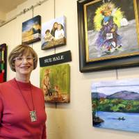 Photo - Sue Hale, who's paintings will be featured in a new exhibit to raise funds for EduCare, shows some of her work at her studio in the Paseo district in Oklahoma City, OK, Monday, October 29, 2012,  By Paul Hellstern, The Oklahoman