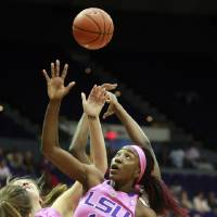 Photo - LSU guard Raigyne Moncrief (11) battles for a rebound against South Carolina in the first half of an NCAA college basketball game in Baton Rouge, La., Sunday, Feb. 16, 2014. (AP Photo/Tim Mueller)