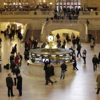 Photo - FILE- In this Jan. 9, 2013 file photo, pedestrians and travelers stroll through the main concourse of Grand Central Terminal in New York. The landmark, one of the country's finest examples of Beaux Arts architecture and the most famous train station in America is celebrating it's 100th anniversary on February 1. (AP Photo/Kathy Willens, File)