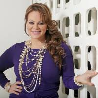 Photo - FILE - In this March 8, 2012, file photo, Mexican-American singer and reality TV star Jenni Rivera poses during an interview in Los Angeles. The family of Rivera, who died in a plane crash in December,  are expected to file a lawsuit against the operator of the private jet company. (AP Photo/Reed Saxon, file)