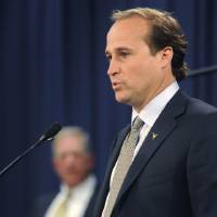 Photo -  Newly named West Virginia football offensive coordinator Dana Holgorsen speaks during a news conference in Morgantown, W.Va., on Wednesday, Dec. 22, 2010. After one season as offensive coordinator, Holgorsen will take over for coach Bill Stewart in 2012. (AP Photo/The Dominion-Post) ORG XMIT: WVMOR102