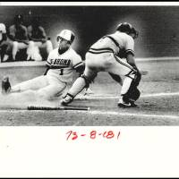 Photo - Oklahoma States' Anthony Blackmon slides into home plate to score ahead of the throw fielded by Appalachian State catcher Brad Long. Staff Photo by Doug Hoke. Original Photo 05/23/1986. Published on O-5-24-86.  Doug Hoke - Daily Oklahoman