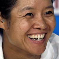 Photo - Li Na of China speaks during a press conference ahead of Saturday's women's singles final against Dominika Cibulkova of Slovakia, at the Australian Open tennis championship in Melbourne, Australia, Friday, Jan. 24, 2014. (AP Photo/Aijaz Rahi)