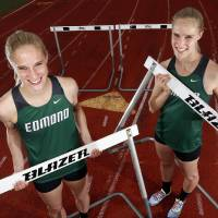 Photo - Edmond Santa Fe hurdlers and twin sisters Erin Hart, left, and Emily Hart pose for a photo at the Edmond Santa Fe High School track in Edmond, Okla.,  Thursday, May 9, 2013. Photo by Nate Billings, The Oklahoman