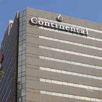 Photo - The Continental Resources sign hangs on the former headquarters of Devon Energy at 20 North Broadway in downtown Oklahoma City. (AP Photo/The Oklahoman, Paul B. Southerland)  Paul B. Southerland - AP