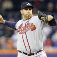 Photo - Atlanta Braves' Aaron Harang delivers a pitch during the first inning of a baseball game against the New York Mets, Friday, April 18, 2014, in New York. (AP Photo/Frank Franklin II)