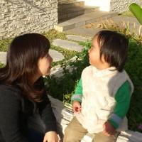 Photo - In this photo released by Minaho Kubota, Kubota chats with her two-year-old son in Naha, Okinawa, Japan. Petrified of the radiation spewing from the Fukushima Dai-ichi nuclear plant that went into multiple meltdowns last year, Kubota grabbed her children, left her skeptical husband and moved to the small southwestern island. AP photo   - AP photo