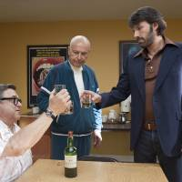 Photo - FILE - This publicity image released by Warner Bros. Pictures shows John Goodman, left, Alan Arkin, center, and actor-director Ben Affleck in a scene from