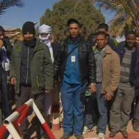 Photo - Unidentified rescued hostages pose for the media in Ain Amenas, Algeria, in this image taken from television  Friday Jan. 18, 2013. Algeria's state news service says nearly 100 out of 132 foreign hostages have been freed from a gas plant where Islamist militants had held them captive for three days.  The APS news agency report was an unexpected indication of both more hostages than had previously been reported and a potentially breakthrough development in what has been a bloody siege. (AP Photo/Canal Algerie  via Associated Press TV)  **  TV OUT   ALGERIA OUT  **