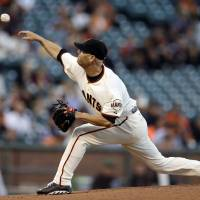 Photo - San Francisco Giants' Tim Hudson works against the Colorado Rockies in the first inning of a baseball game Wednesday, Aug. 27, 2014, in San Francisco. (AP Photo/Ben Margot)