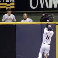 Photo - Milwaukee Brewers right fielder Ryan Braun (8) cannot catch a two-run RBI double hit by Pittsburgh Pirates' Josh Harrison during the second inning of a baseball game Friday, Aug. 22, 2014, in Milwaukee. (AP Photo/Darren Hauck)