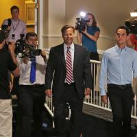 Photo - Republican 7th District congressional candidate Dave Brat, center, arrives for a Rotary Club breakfast in Richmond, Va., Tuesday, June 17, 2014.  Brat defeated House Majority Leader Eric Cantor in last week's Republican primary. (AP Photo/Steve Helber)