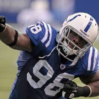Photo -   FILE - In this file photo taken Dec. 18, 2011, Indianapolis Colts defensive end Robert Mathis celebrates a turnover by the Tennessee Titans during the fourth quarter of an NFL football game in Indianapolis. For the first time in more than a decade, the Colts are not expected to contend for a division title or make the playoffs. Players understand this is reality for 2012, they just don<t believe in using the r-word. (AP Photo/Darron Cummings, File)
