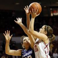 Photo - Oklahoma's Morgan Hook (10) shoots against Kansas State's Brianna Craig (20) during an NCAA women's college basketball game between the University of Oklahoma (OU) and Kansas State at Lloyd Noble Center in Norman, Okla., Wednesday, Feb. 20, 2013. Photo by Nate Billings, The Oklahoman