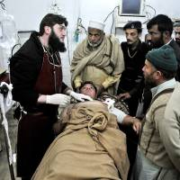 Photo - A Pakistani driver who survived an attack on a van which was targeted by gunmen in Swabi , lies at the Lady Reading Hospital bed after being admitted for treatment, in Peshawar, Pakistan, Tuesday, Jan. 1, 2013. Gunmen killed several female teachers and two other people on Tuesday in an ambush on a van carrying workers home from their jobs at a community center in northwest Pakistan, officials said. The attack was a reminder of the risks faced by educators and aid workers, especially women, in an area where Islamic militants often target women and girls trying to get an education or female teachers working with both genders. (AP Photo/Mohammad Sajjad)