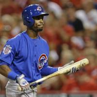 Photo - Chicago Cubs' Arismendy Alcantara walks to the dugout after striking out in the eighth inning of a baseball game against the Cincinnati Reds, Wednesday, July 9, 2014, in Cincinnati. Cincinnati won 4-1. (AP Photo/Al Behrman)