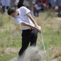 Photo - Amateur, Matthew Fitzpatrick, England, hits from the fairway on the 18th hole during the final round of the U.S. Open golf tournament in Pinehurst, N.C., Sunday, June 15, 2014. (AP Photo/Eric Gay)