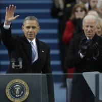 Photo - President Barack Obama waves after his speech while Vice President Joe Biden applauds at the ceremonial swearing-in at the U.S. Capitol during the 57th Presidential Inauguration in Washington, Monday, Jan. 21, 2013. (AP Photo/Pablo Martinez Monsivais)