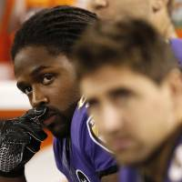 Photo -   Baltimore Ravens wide receiver Torrey Smith, left, looks on from the sideline during the second half of an NFL football game against the New England Patriots in Baltimore, Sunday, Sept. 23, 2012. Smith's younger brother was killed late Saturday in a motorcycle accident in northeast Virginia. (AP Photo/Patrick Semansky)