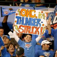 Photo -  Fans cheer during the opening NBA basketball game between the Oklahoma City Thunder and the Milwaukee Bucks at the Ford Center in Oklahoma City, Wednesday, October 29, 2008.  BY BRYAN TERRY, THE OKLAHOMAN