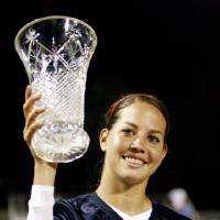 Photo - U.S., UNITED STATES: Cat Osterman holds up the World Cup following the World Cup of Softball championship game between USA and Japan at ASA Softball Stadium in Oklahoma City, Monday, July 16, 2007. USA won 3-0. By Matt Strasen, The Oklahoman ORG XMIT: KOD