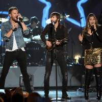 "Photo -  Charles Kelley, and from left, Dave Haywood and Hillary Scott, of the musical group Lady Antebellum, perform at ""ACM Presents an All-Star Salute to the Troops"" on Monday, April 7, 2014, in Las Vegas. (AP)"