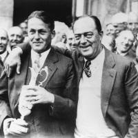 Photo - FILE - In this July 22, 1927, file photo, American amateur Bobby Jones, left, poses with his father, Robert, after winning the British Open at St. Andrews, Scotland. Jones not only was the best amateur in U.S. Open history, he remains one of the greatest to ever play the game and is celebrated for his