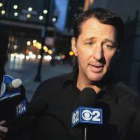 Photo - FILE - In this Oct. 28, 2013 file photo, television infomercial pitchman Kevin Trudeau speaks to the media after leaving the Metropolitan Correctional Center in downtown Chicago. On Monday, March 17, 2014, a federal judge in Chicago is scheduled to sentence Trudeau for bilking consumers through his infomercials. In November 2013, jurors convicted Trudeau for defying a court order barring him from running infomercials that made false claims about his book,