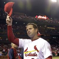 Photo -   St. Louis Cardinals manager Mike Matheny tips his cap to the crowd after the Cardinals' 1-0 victory over the Cincinnati Reds in a baseball game, Wednesday, Oct. 3, 2012, in St. Louis. (AP Photo/Jeff Roberson)