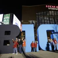 Photo -  Fans pose for photos outside of Lucas Oil Stadium before the Big Ten Conference championship NCAA college football game between Wisconsin and Nebraska, Saturday, Dec. 1, 2012, in Indianapolis. (AP Photo/AJ Mast)  ORG XMIT: NAS101