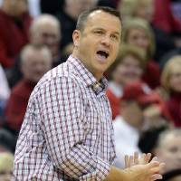 Photo - Louisville head coach Jeff Walz shouts instructions to his team during the first half of their NCAA college basketball game against Eastern Kentucky, Wednesday, Nov. 28, 2012, in Louisville, Ky. (AP Photo/Timothy D. Easley)