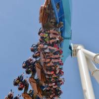 Photo - FILE - This May 9, 2013 file photo released by Cedar Point shows riders testing the new, $30 million winged rollercoaster called GateKeeper at Cedar Point park in Sandusky, Ohio.Cedar Point, the company's flagship park in Sandusky added two new family rides this year with just enough thrill to keep the entire family happy. (AP Photo/Cedar Point, File)