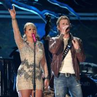 Photo - From left, country music stars Miranda Lambert, who lives in Tishomingo, and Dierks Bentley perform at the 55th annual Grammy Awards on Sunday, Feb. 10, 2013, in Los Angeles. They will bring their ?Locked & Reloaded Tour? to Tulsa's BOK Center for an April 13 show. (Photo by John Shearer/Invision/AP)  John Shearer - John Shearer/Invision/AP