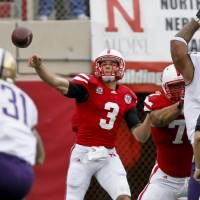 Photo - Nebraska's Taylor Martinez throws during the first half of an NCAA college football game against Washington, Saturday, Sept. 17, 2011, in Lincoln, Neb. Martinez threw for two touchdowns and ran for a third, and No. 11 Nebraska held off Washington for a wild 51-38 victory.  (AP Photo/Nati Harnik) ORG XMIT: NENH118