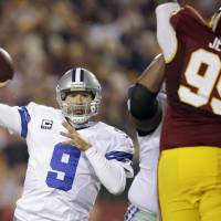 Photo - File- This Dec. 30, 2012 file photo shows Dallas Cowboys quarterback Tony Romo (9) throwing a pass during the first half of an NFL football game against the Washington Redskins in Landover, Md.  Romo and the Cowboys have agreed on a six-year contract extension worth $108 million, with about half of that guaranteed.  The agreement was reported on the team's website Friday March 29, 2013. (AP Photo/Evan Vucci, File)