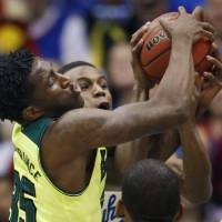 Photo - Baylor forward Taurean Prince, left, goes for a rebound against Kansas guard Andrew Wiggins during the first half of an NCAA college basketball game in Lawrence, Kan., Monday, Jan. 20, 2014. (AP Photo/Orlin Wagner)