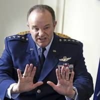 Photo - NATO Supreme Allied Commander Europe, U.S. Air Force General Philip Breedlove gestures during an interview with the Associated Press in Paris, Wednesday April 9, 2014, as he talks about his mission to formulate a plan to help protect and reassure NATO members nearest Russia. NATO's top military commander in Europe, Breedlove is tasked with drafting countermoves to the perceived Russian military threat against Ukraine. (AP Photo/Remy de la Mauviniere)