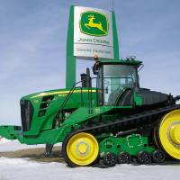 Photo -   FILE- In this Feb. 13, 2011, file photo, a John Deere tractor is parked at the Stevens Implement Company, a John Deere dealership, in Petersburg, Ill. Deere & Co. said Wednesday, Nov. 21, 2012, that it earned $687.6 million for the quarter, or $1.75 per share. (AP Photo/Seth Perlman, File)