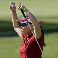 Photo - Oklahoma's Chirapat Jao-Javanil celebrates after finishing her final round at the NCAA Division I women's golf championship Friday, May 25, 2012, in Franklin, Tenn. Jao-Javanil won the individual championship at 6-under-par 282. (AP Photo/Mark Humphrey) ORG XMIT: TNMH103