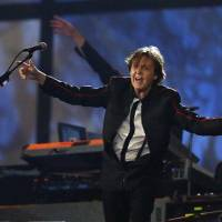 Photo - Paul McCartney performs during the Opening Ceremony at  the 2012 Summer Olympics, Saturday, July 28, 2012, in London. (AP Photo/Matt Dunham, Pool)