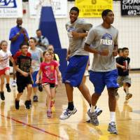 Photo - Current University of Tulsa basketball players lead drills as former NBA All-Stars Danny Manning, Otis Birdsong and Michael Ray Richardson host a basketball clinic for tornado victims on Thursday, June 13, 2013 in Moore, Okla.  Photo by Steve Sisney, The Oklahoman