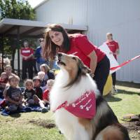Photo -  Lassie, the new Save The Children ambassador, barks during the groundbreaking for a new storm shelter at Agapeland Learning Center in Moore. Photo provided   PROVIDED