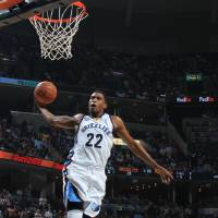 Photo -   Memphis Grizzlies forward Rudy Gay (22) elevates for a dunk against the Dallas Mavericks in the first half of an NBA basketball game on Saturday, April 7, 2012, in Memphis, Tenn. (AP Photo/Nikki Boertman)